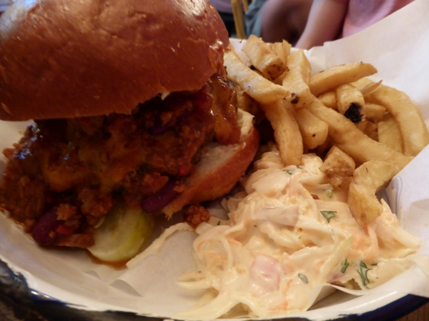 Buttermilk fried chicken burger with jalepeno coleslaw, melted cheddar and skin-on chips (£10.00)