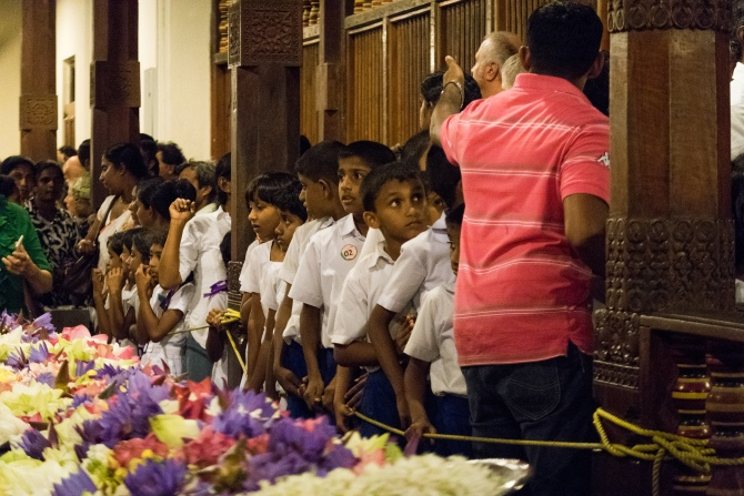 School children queue up for their turn to catch a glimpse of the casket that holds the Tooth.